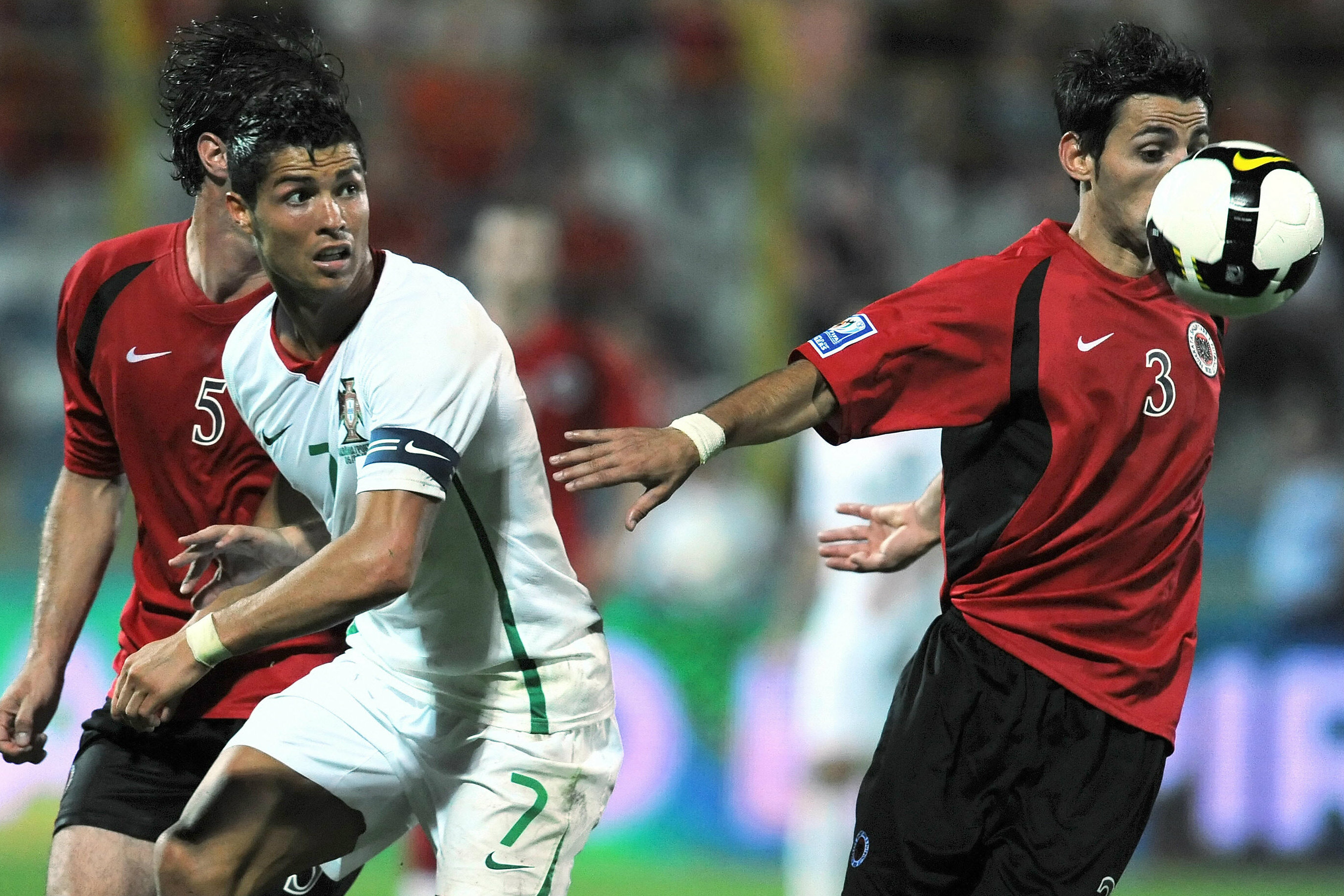 Kristi Vangjeli holds off Cristiano Ronaldo as Albania fought out a 0-0 draw with Portugal in 2009