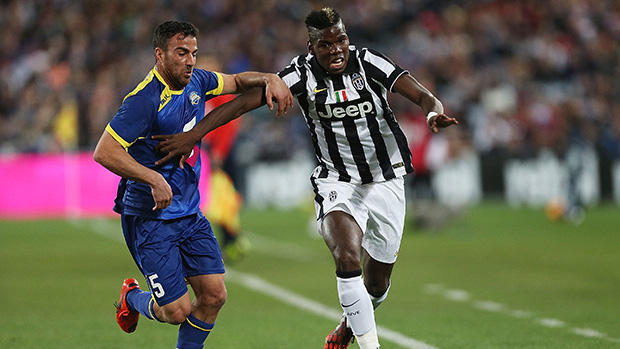 Juventus' Paul Pogba fends off attention from All Star Manny Muscat.