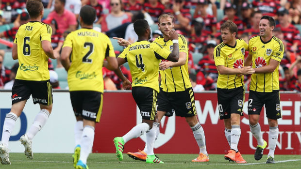 Wellington celebrate one of Blake Powell's three first-half goals against the Wanderers on Sunday.