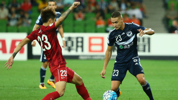 Shanghai SIPG's Huan Fu challenges Jai Ingham for the ball in the ACL at Melbourne Rectangular Stadium.