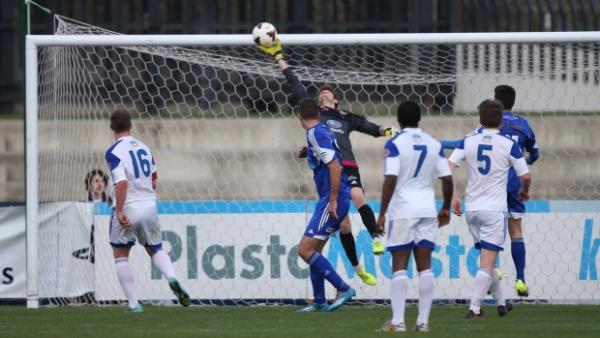 Olympia FC keeper Sean Lewis reels off one of a host of impressive saves as the Warriors eliminated South Melbourne FC.